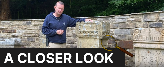 Andrew Birley in front of the replica altars at Vindolanda